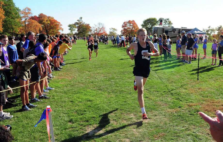Staples' Christian Myers crosses the finish line in FCIAC Boys Cross Country Championship race action at Wavenly Park in New Canaan, Conn. on Wednesday Oct. 19, 2016. Photo: Christian Abraham / Hearst Connecticut Media / Connecticut Post