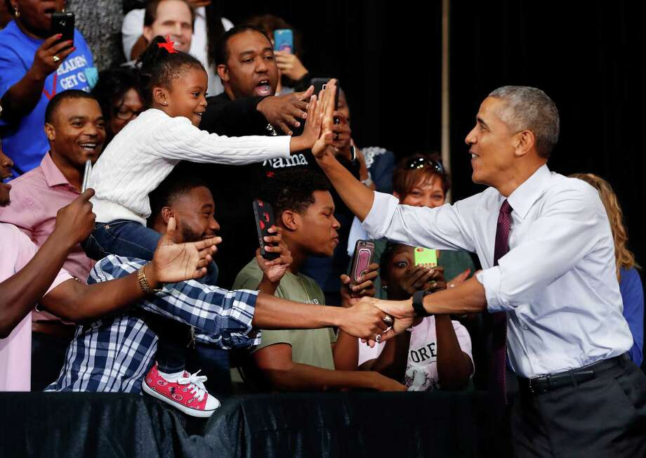 President Barack Obama greets supporters at Fayetteville State University, Friday, Nov. 4, 2016 in Fayetteville, N.C., during a campaign rally for Democratic presidential candidate Hillary Clinton. Photo: Pablo Martinez Monsivais, AP / Copyright 2016 The Associated Press. All rights reserved.