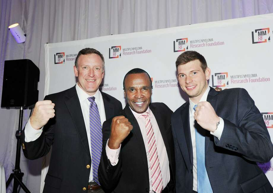 Sugar Ray Leonard, center, strikes a pose with Andrew Crawford, of Fairfield, left, and Stamford resident Ben Bergin. Photo: Bob Luckey Jr. / Hearst Connecticut Media / Greenwich Time