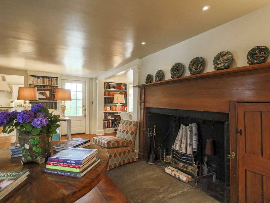 The over-sized fireplace suggests that this room in the colonial at 2860 Bronson Road was the original kitchen of the updated antique house, built in 1767. It is now the keeping room. Photo: Contributed Photos