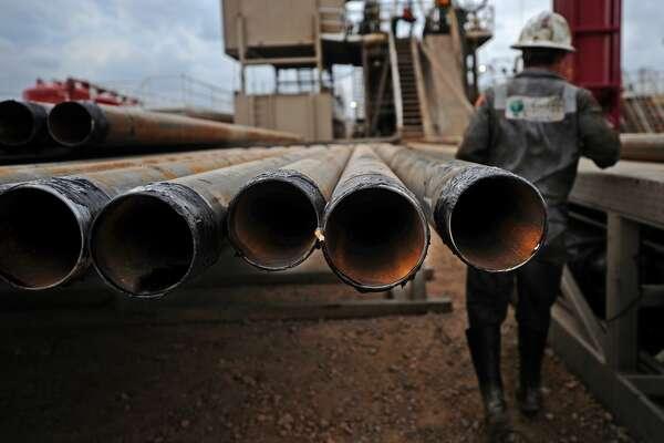 Casing sits on a rack near Trinidad Drilling Rig 433 on Wednesday, Nov. 2, 2016, in Midland County. James Durbin/Reporter-Telegram