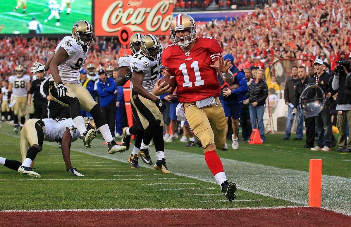 San Francisco 49ers quarterback Alex Smith scores a touchdown against the New Orleans Saints in the fourth quarter of a 2012 NFL divisional playoff game at Candlestick Park.