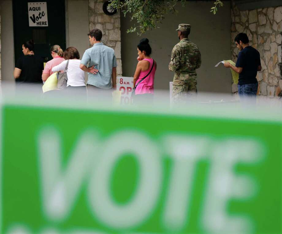 Voters wait in line to cast ballots at an early polling site, Friday, Nov. 4, 2016, in San Antonio. Friday is the last day of early voting in Texas. The polls will reopen on Election Day, Tuesday, Nov. 8. (AP Photo/Eric Gay) Photo: Eric Gay / Copyright 2016 The Associated Press. All rights reserved.