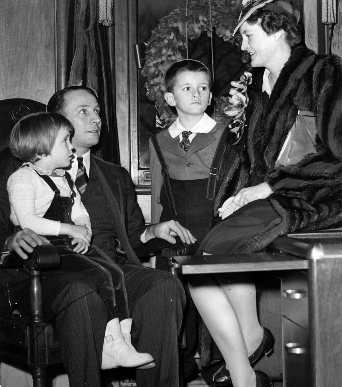 Mayor Erastus Corning II, left, poses with children, Bettina Corning Dudley, left, Erastus Corning III and wife Elizabeth Platt, right, Jan. 2, 1942, in Albany, N.Y. Historic 1940s. (Times Union archive)