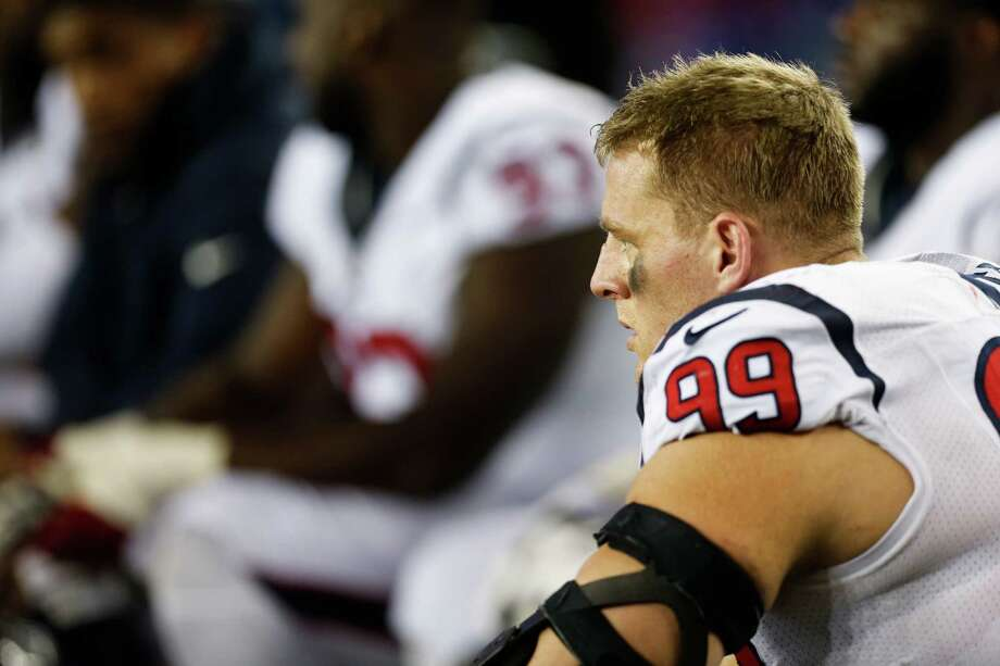 Houston Texans defensive end J.J. Watt sits on the sidelines during the second quarter of an NFL football game against the New England Patriots at Gillette Stadium on Thursday, Sept. 22, 2016, in Foxborough, Mass. ( Brett Coomer / Houston Chronicle ) Photo: Brett Coomer, Staff / © 2016 Houston Chronicle