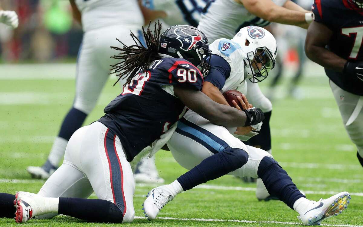 Houston Texans defensive end Jadeveon Clowney (90) sacks Tennessee Titans quarterback Marcus Mariota (8) during the third quarter of an NFL football game at NRG Stadium, Sunday, Oct. 2, 2016 in Houston. ( Karen Warren / Houston Chronicle )