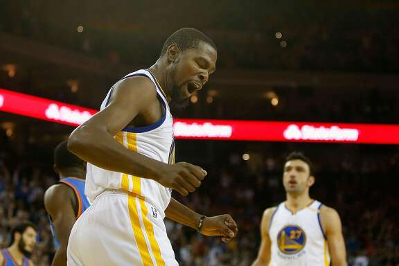OAKLAND, CA - NOVEMBER 03: Kevin Durant #35 of the Golden State Warriors reacts after dunking the ball against the Oklahoma City Thunder at ORACLE Arena on November 3, 2016 in Oakland, California. NOTE TO USER: User expressly acknowledges and agrees that, by downloading and or using this photograph, user is consenting to the terms and conditions of Getty Images License Agreement. (Photo by Lachlan Cunningham/Getty Images)