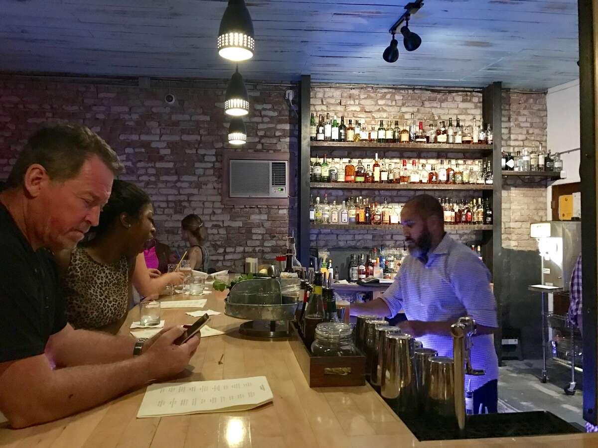 DTO co-founder, IanRamirez, tends bar on a busy Saturday night.