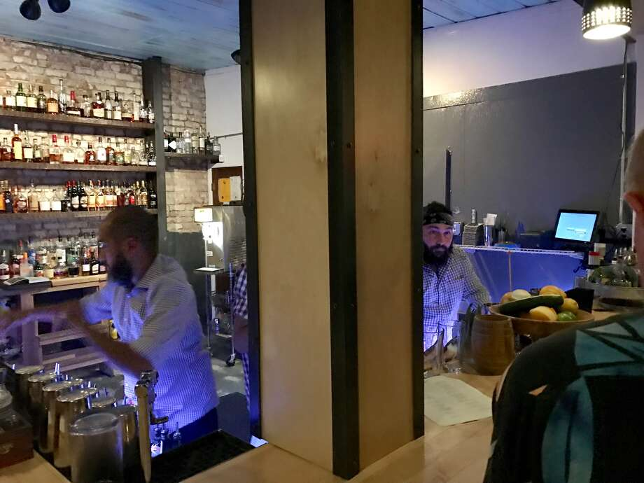 DTO co-founders Ian Ramirez, left, and Brad Stringer, right, on a busy Saturday night service. Photo: Darla Guillen/Houston Chronicle