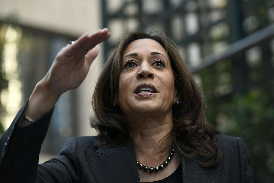 Attorney General Kamala Harris, a candidate for Senate, speaks to the crowd as she joins BART Board candidate Lateefah Simon for a campaign rally on Market St. in San Francisco CA, November 4, 2016. Photo: Michael Short, Special To The Chronicle
