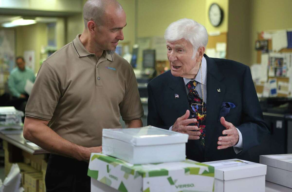 Jita Printing founder and CEO Jeffrey Offutt speaks with his mentor, Bill Spitz, at Offutt's business in Houston. Offutt is the graduate of a program that helps ex-cons gain employment and start new businesses.