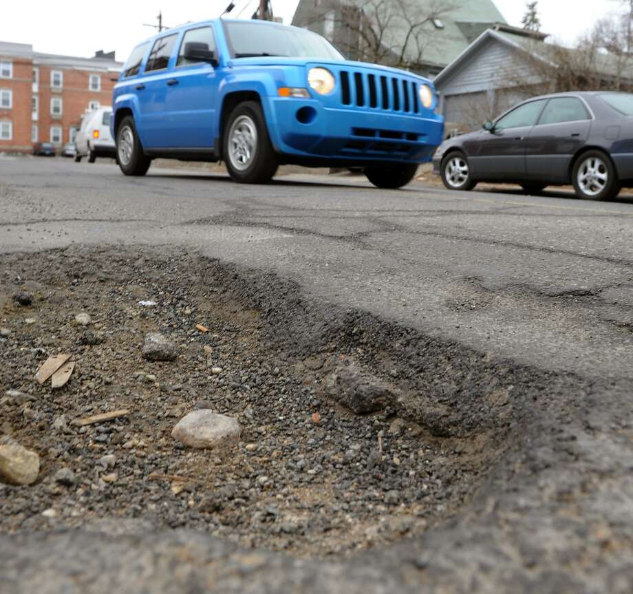 A large pothole on Granfield Avenue in Bridgeport, Conn. The Bridgeport and Stamford region has the sixth worst roads in the nation, and all those bumpy rides cost drivers nearly $800 in annual repairs, a new study concluded. Photo: Christian Abraham / Hearst Connecticut Media File Photo / Connecticut Post