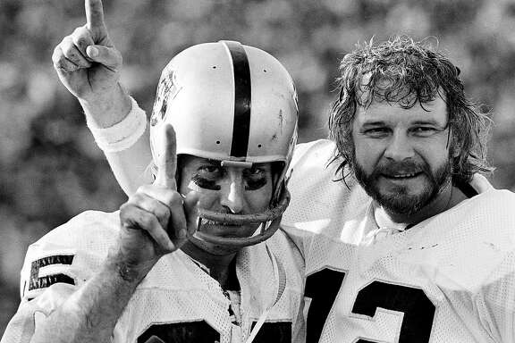 Receiver Fred Biletnikoff, left, and quarterback Ken Stabler celebrate after the Oakland Raiders defeated the Minnesota Vikings in Super Bowl XI in Pasadena, Calif. Jan. 9, 1977. The Oakland Raiders will face the Tampa Bay Buccaneers in in Super Bowl XXXVII in San Diego Sunday, Jan. 26, 2003.(AP Photo/File)