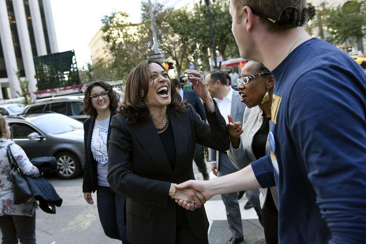 Attorney General Kamala Harris, a candidate for Senate, laughs as she speaks with a supporter while joining BART Board candidate Lateefah Simon for a campaign rally on Market St. in San Francisco CA, November 4, 2016.