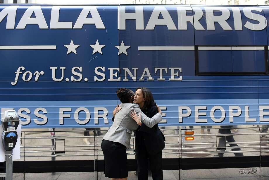 Attorney General Kamala Harris (right), front-runner for U.S. Senate, hugs Lateefah Simon, a candidate for the BART Board of Directors, with Harris' campaign bus as a backdrop in S.F. Photo: Michael Short, Special To The Chronicle