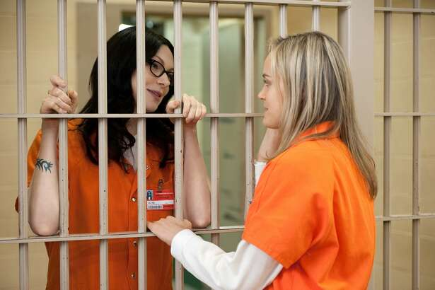 """Laura Prepon (L) and Taylor Schilling (R) in a scene from Netflix's """"Orange is the New Black"""" Season 2. Photo credit: JoJo Whilden for Netflix"""