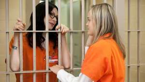 "Laura Prepon (L) and Taylor Schilling (R) in a scene from Netflix's ""Orange is the New Black"" Season 2. Photo credit: JoJo Whilden for Netflix"