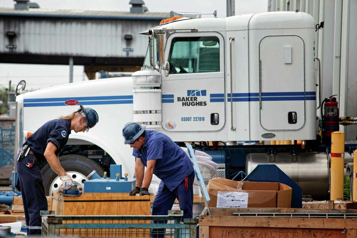 Workers organize parts outside of the main assembly warehouse, at the Baker Hughes facility, Thursday, May 12, 2011 in Tomball, Texas. (Todd Spoth/For the Chronicle)