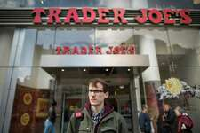Thomas Nagle is outside the Trader Joe's in New York where he was fired. Employees of the grocery chain are complaining of harsh treatment by managers and a pressure to appear happy. despite the atmosphere they work in. (Joshua Bright/The New York Times)
