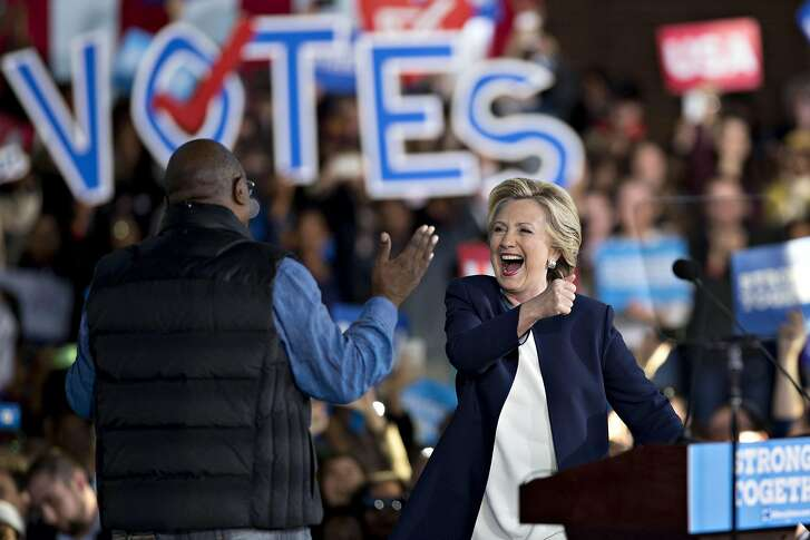 Hillary Clinton, 2016 Democratic presidential nominee, smiles during a campaign event in Detroit, Michigan, U.S., on Friday, Nov. 4, 2016. As the U.S. presidential race heads into its final weekend, Donald Trump is showing strength in Iowa and Ohio pre-Election Day voting, while Clinton's advantage in early balloting looks stronger in North Carolina and Nevada. Photographer: Daniel Acker/Bloomberg