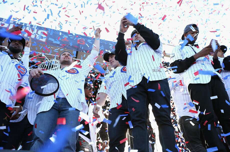 Cubs players celebrating in Chicago's Grant Park included, from left, Dexter Fowler, Jon Lester, Anthony Rizzo, Javier Baez and Carl Edwards Jr. Photo: Jonathan Daniel, Getty Images