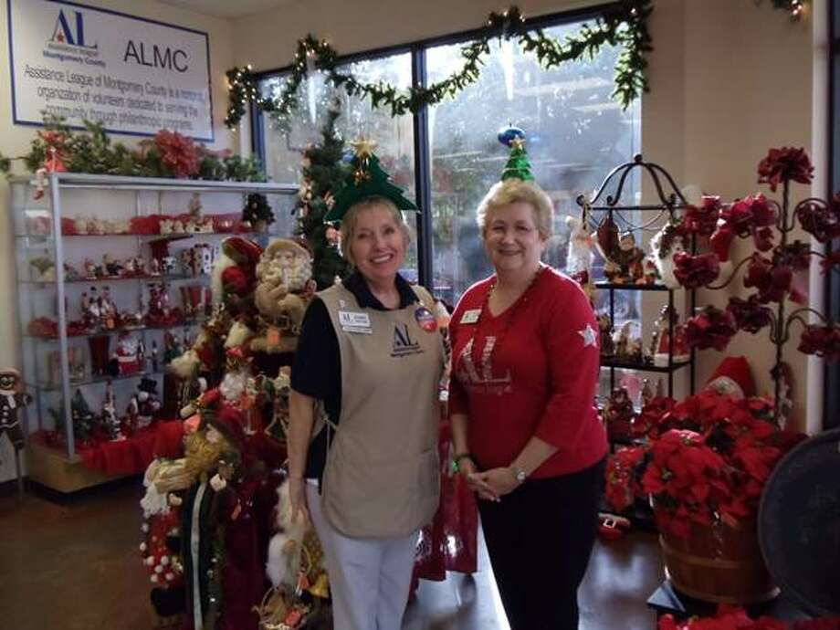 Rosemary Spafford, left, and Phyllis Loft, right, are pictured at a previous Christmas Preview fundraiser for the Assistance League of Montgomery County. On Nov. 14, from 4 to 7 p.m., ALMC volunteers will put out the best Christmas items to raise money for the group's Operation School Bell program.