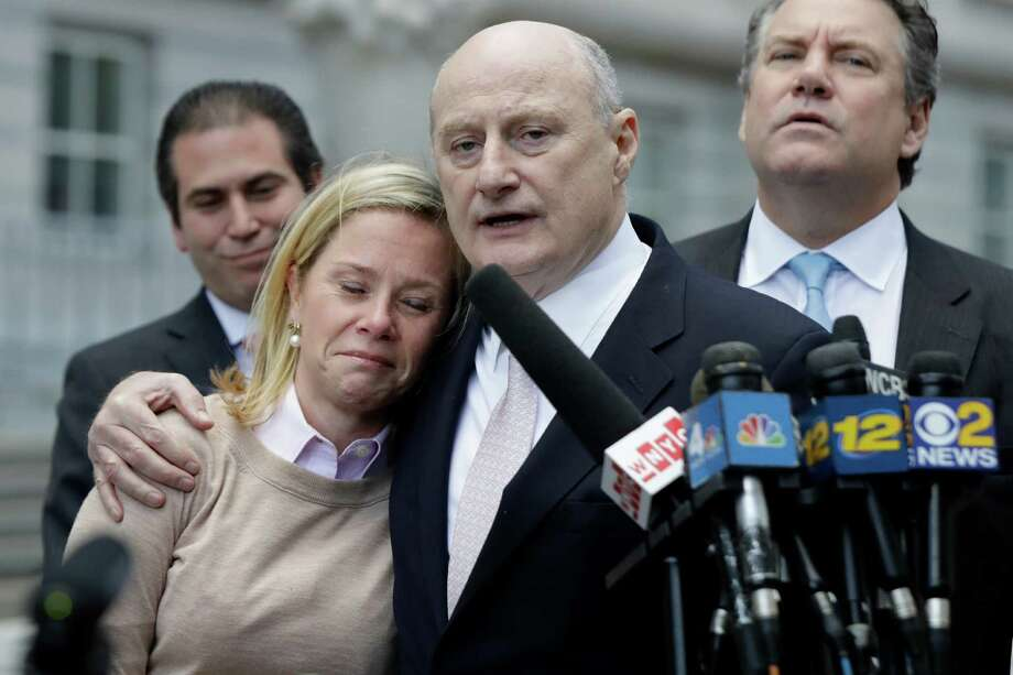 Bridget Anne Kelly, left, former Deputy Chief of Staff for New Jersey Gov. Chris Christie, is held by her lawyer Michael Critchley while talking to reporters after she was found guilty on all counts in the George Washington Bridge traffic trial at Martin Luther King, Jr., Federal Court, Friday, Nov. 4, 2016, in Newark, N.J. (AP Photo/Julio Cortez) Photo: Julio Cortez, STF / Copyright 2016 The Associated Press. All rights reserved.