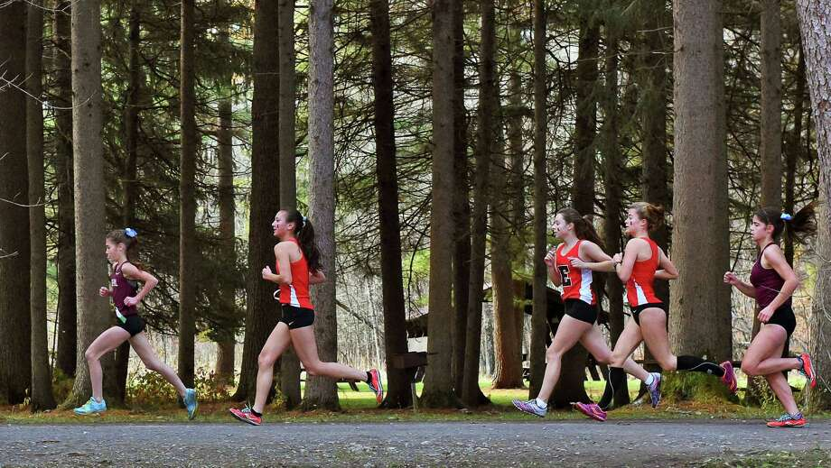 Class B girls run along park trails during the Section II cross country championships at Saratoga Spa State Park Friday Nov. 4, 2016 in Saratoga Springs, NY.  (John Carl D'Annibale / Times Union) Photo: John Carl D'Annibale / 20038667A