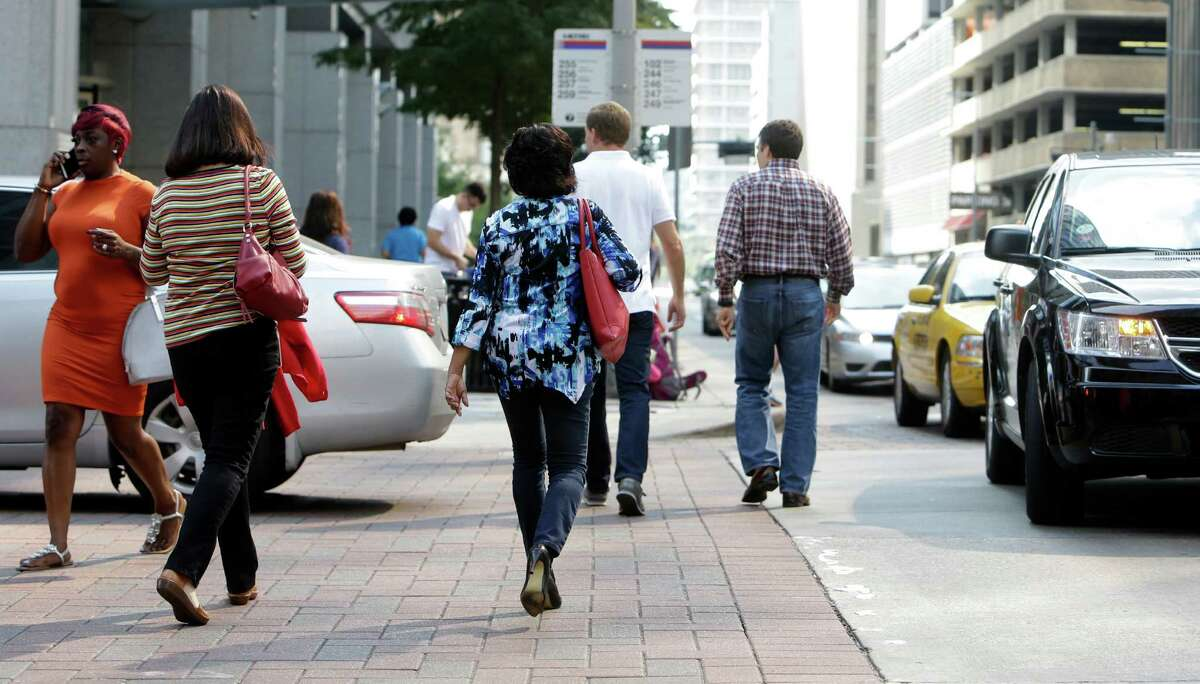Pedestrians are shown in downtown Friday, Nov. 4, 2016, in Houston.