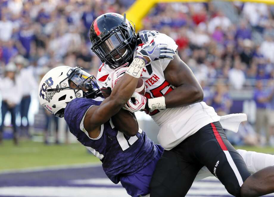 Texas Tech defensive back Douglas Coleman, right, intercepts a pass at the goal line intended for TCU wide receiver KaVontae Turpin, left, in the second half of an NCAA college football game, Saturday, Oct. 29, 2016, in Fort Worth, Texas. Texas Tech won in double overtime, 27-24. (AP Photo/Tony Gutierrez) Photo: Tony Gutierrez/Associated Press