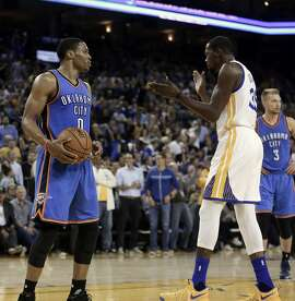 Golden State Warriors' Kevin Durant, right, celebrates in front of Oklahoma City Thunder guard Russell Westbrook (0) during the first half of an NBA basketball game Thursday, Nov. 3, 2016, in Oakland, Calif. (AP Photo/Ben Margot)