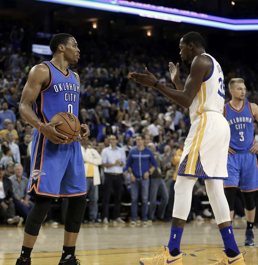 Golden State Warriors' Kevin Durant, right, celebrates in front of Oklahoma City Thunder guard Russell Westbrook (0) during the first half of an NBA basketball game Thursday, Nov. 3, 2016, in Oakland, Calif. (AP Photo/Ben Margot) Photo: Ben Margot, Associated Press