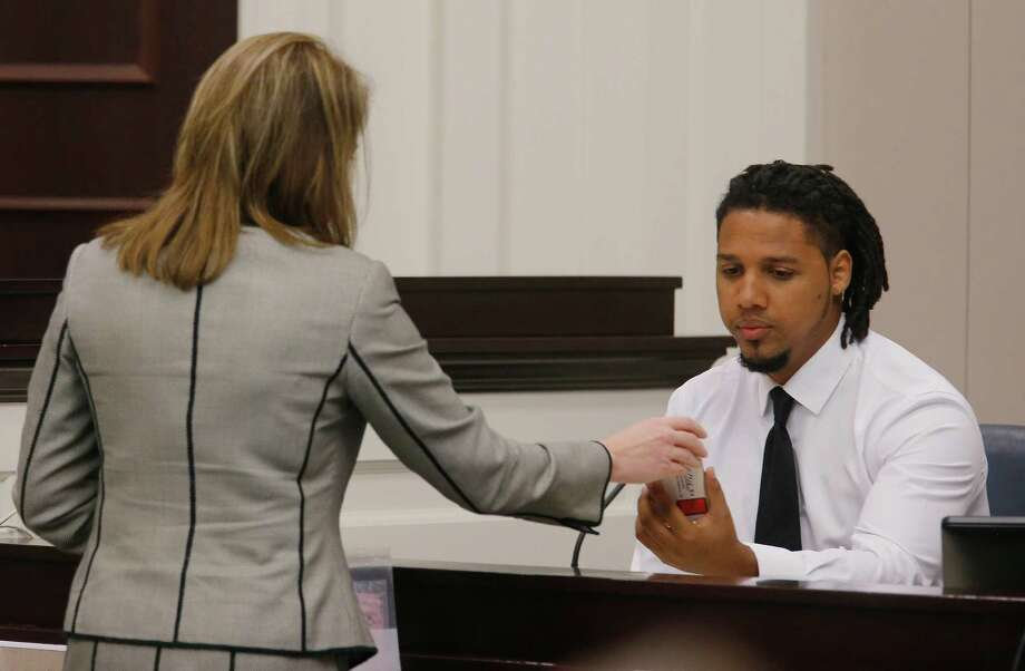 Ninth Circuit Solicitor Scarlett Wilson, left, speaks with Feiden Santana, who made the cell video showing former North Charleston Police Officer Michael Slager's fatal encounter with Walter Scott, as Santana testifies in Slager's murder trial, Friday, Nov. 4, 2016, in Charleston, S.C. Slager is on trial facing a murder charge in the shooting death of Walter Scott, who was gunned down after he fled from a traffic stop. (Grace Beahm/Post and Courier via AP, Pool, File) Photo: Grace Beahm, POOL / Post and Courier POOL