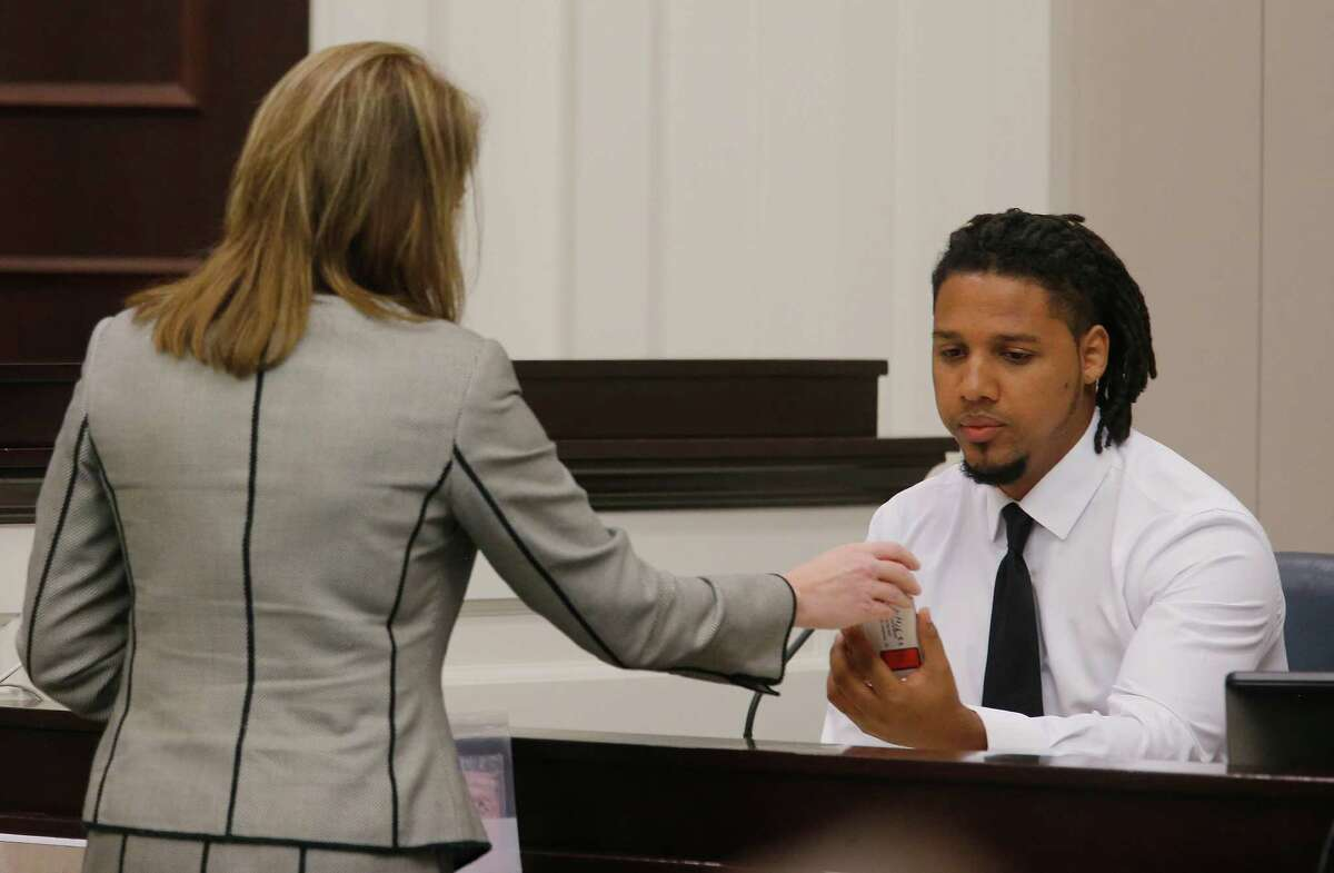 Ninth Circuit Solicitor Scarlett Wilson, left, speaks with Feiden Santana, who made the cell video showing former North Charleston Police Officer Michael Slager's fatal encounter with Walter Scott, as Santana testifies in Slager's murder trial, Friday, Nov. 4, 2016, in Charleston, S.C. Slager is on trial facing a murder charge in the shooting death of Walter Scott, who was gunned down after he fled from a traffic stop. (Grace Beahm/Post and Courier via AP, Pool)