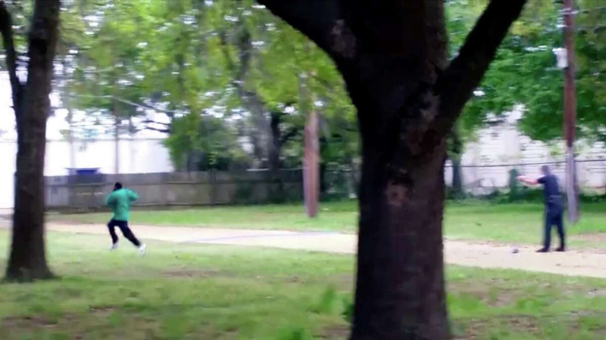 In this April 4, 2015 image from video, Walter Scott, left, is shot by police officer Michael Thomas Slager in Charleston, S.C. On Friday, Nov. 4, 2016, prosecutors called to the stand Feidin Santana, a bystander who took this cellphone video. Slager faces 30 years to life if convicted of murder in the slaying. (Feidin Santana via AP)
