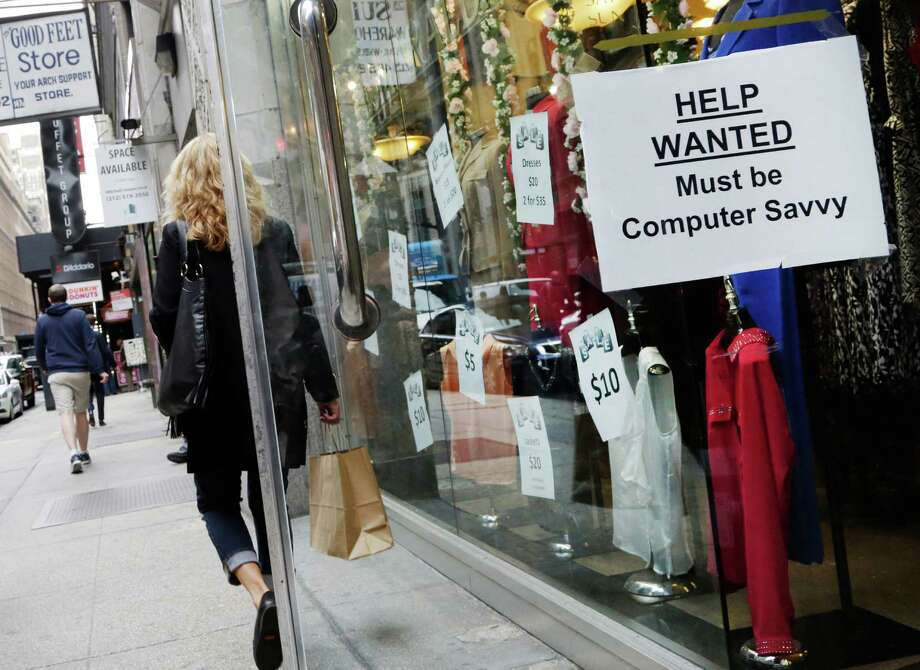 "FILE - In this Oct. 1, 2015, file photo, a shopper walks past a store with a ""Help Wanted"" sign in the window, in New York. On Wednesday, Nov. 2, 2016, payroll processor ADP reports on the number of jobs private employers added in October. (AP Photo/Mark Lennihan, File) Photo: Mark Lennihan, STF / Copyright 2016 The Associated Press. All rights reserved."