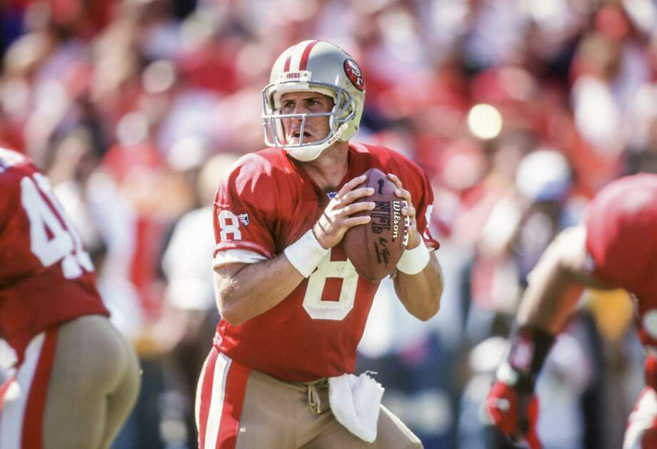 SAN FRANCISCO -  SEPTEMBER 17:  Steve Young #8 of the San Francisco 49ers looks to throw a pass during a National Football League game against the New England Patriots played on September 17, 1995 at Candlestick Park in San Francisco, California.  (Photo by David Madison/Getty Images) Photo: David Madison / Getty Images / 1995 David Madison