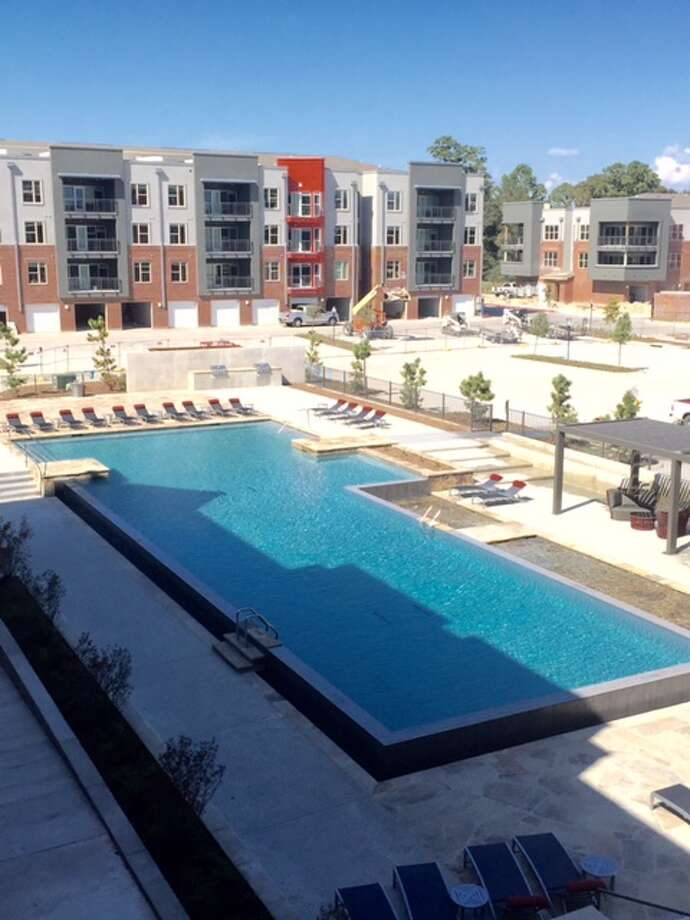 An infinity pool is among the amenities at the Anatole at the Pines, at 1100 S. Loop 336 West in Conroe.  The four-story property recently opened across from the Grand Central Park community. Photo: NL Development