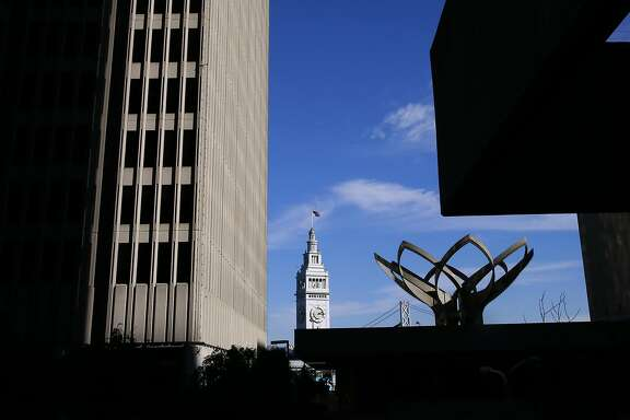 The Ferry Building along the Embarcadero is framed by the Embarcadero buildings across the street in San Francisco, California, on Friday November 4, 2016