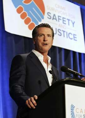 FILE - In this April 20, 2015, file photo, California Lt. Gov. Gavin Newsom speaks at the Californians for Safety and Justice conference in Sacramento, Calif. For the 2016 election, Newsom is leading the campaign for a first-of-its-kind law that would require anyone buying ammunition to pass a background check and obtain a state permit. (AP Photo/Rich Pedroncelli, File)