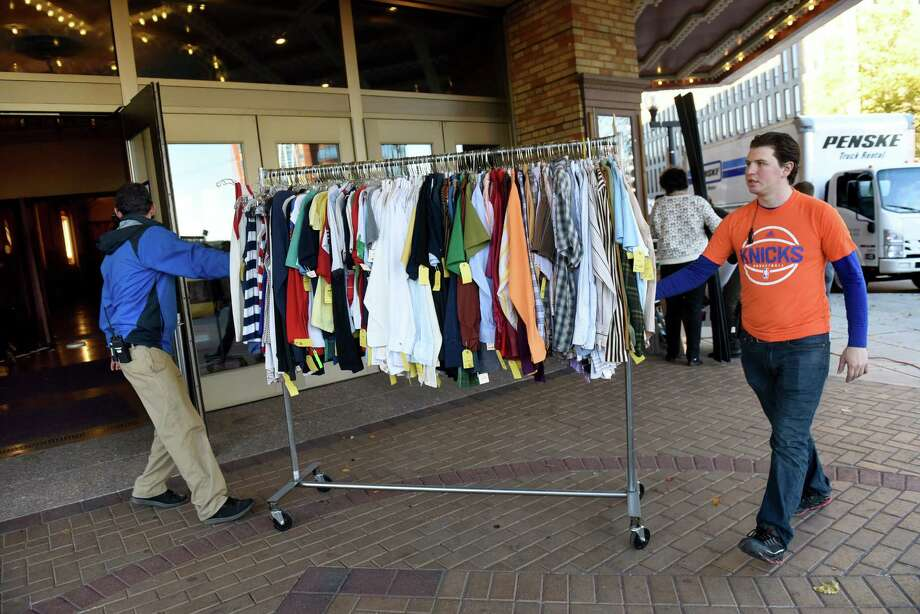 """Set workers bring in some of the wardrobe for filming a scene in """"The Pretenders"""" on Friday, Nov 4, 2016, at the Palace Theatre in Albany, N.Y. (Cindy Schultz / Times Union) Photo: Cindy Schultz / Albany Times Union"""