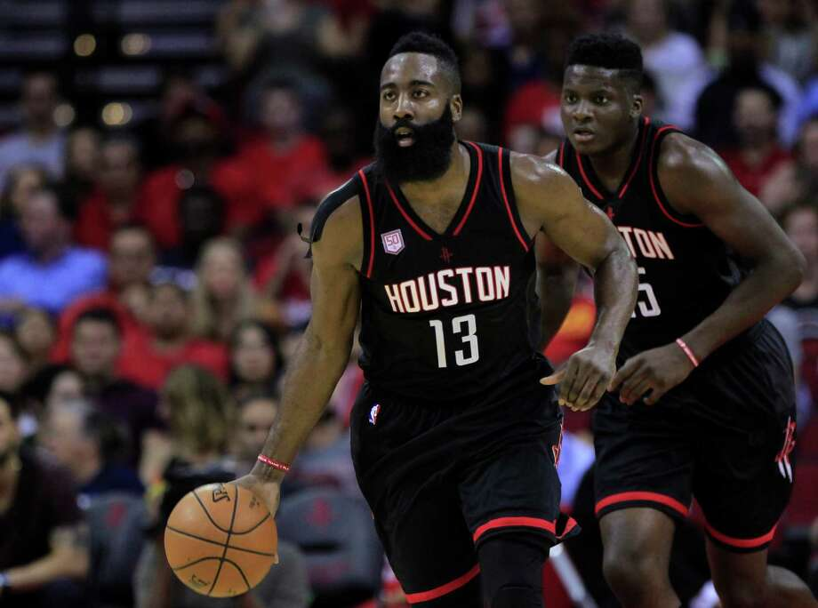 James Harden sizes up the defense as he brings the ball down the court. The Rockets' playmaker will be facing the NBA's No. 2 defense tonight in Atlanta. Photo: Mark Mulligan, Staff / © 2016 Houston Chronicle