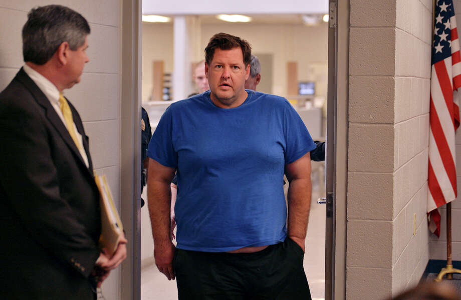 Todd Kohlhepp is escorted into a Spartanburg County magistrate courtroom, Friday, Nov. 4, 2016, in Spartanburg, S.C.. Kohlhepp, a 45-year-old registered sex offender with a previous kidnapping conviction, appeared at a bond hearing Friday on a kidnapping charge in connection to a woman being found chained inside a storage container on a property in Woodruff, S.C. More charges will be filed later, the prosecutor told the court.  (Tim Kimzey/The Spartanburg Herald-Journal via AP) Photo: TIM KIMZEY, MBO / T.KIMZEY f-stop@email.com
