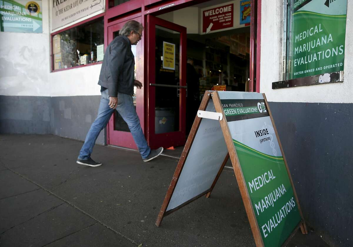 A customer walks into the Amoeba music and record store on Haight Street in San Francisco, Calif. on Thursday, Nov. 3, 2016, where a medical marijuana evaluation center is located on the second floor.