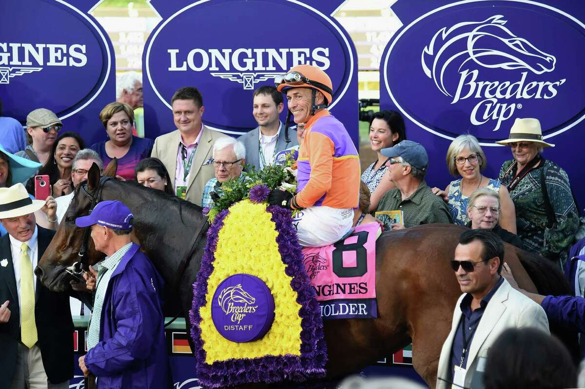 ARCADIA, CA - NOVEMBER 04: Jockey Gary Stevens riding Beholder celebrates in the winner's circle after winning the Longines Breeders' Cup Distaff during day one of the 2016 Breeders' Cup World Championships at Santa Anita Park on November 4, 2016 in Arcadia, California.