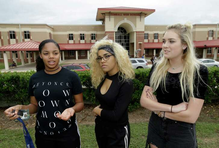 Toni Trail,  left, Jodeci Williams  and Claire Skivington, all 17  and seniors at Tomball High School,  wore black in support of the Black Lives Matter movement this fall.