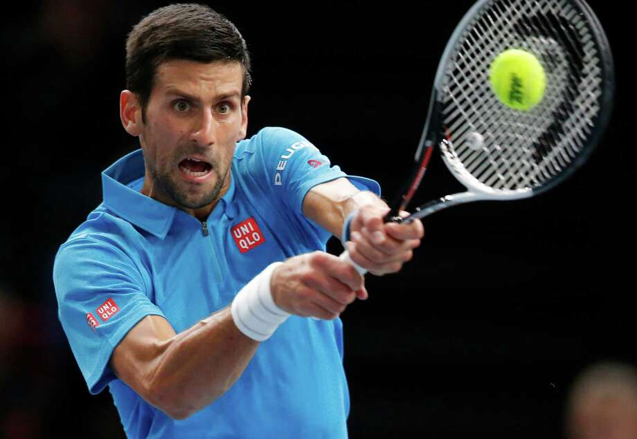 Novak Djokovic of Serbia returns the ball to Marin Cilic of Croatia in the quarterfinal match of the Paris Masters tennis tournament at the Bercy Arena in Paris, Friday, Nov. 4, 2016. Cilic won 6-4, 7-6. (AP Photo/Michel Euler) ORG XMIT: MEU137 Photo: Michel Euler / Copyright 2016 The Associated Press. All rights reserved.