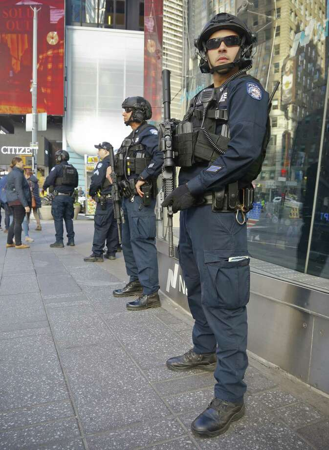 """Officers from the NYPD anti-terror unit patrol Times Square, Friday Nov. 4, 2016, in New York. The FBI and New York Police Department say they are assessing the credibility of information they received of a possible al-Qaida terror attack against the U.S. on the eve of Election Day. Officials say Friday that counterterrorism investigators are reviewing the information that mentioned New York, Texas and Virginia as potential targets. An NYPD spokesman says in a statement the information """"lacks specificity."""" (AP Photo/Bebeto Matthews) Photo: Bebeto Matthews, STF / Associated Press / Copyright 2016 The Associated Press. All rights reserved."""