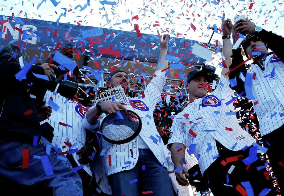Chicago Cubs' Jon Lester holds the Commissioners Trophy as he celebrates with teammates during a celebration honoring the World Series champions at Grant Park in Chicago, Friday, Nov. 4, 2016. (AP Photo/Nam Y. Huh) ORG XMIT: ILNH128 Photo: Nam Y. Huh / Copyright 2016 The Associated Press. All rights reserved.