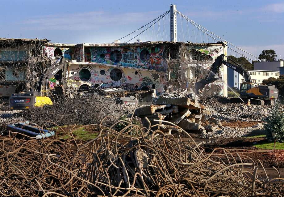 Crews demolish buildings on the western edge of Treasure Island to make room for new housing in the face of rising costs. Photo: Michael Macor, The Chronicle